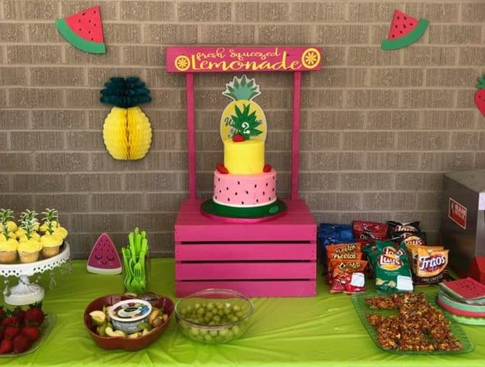 Tutti Frutti Cake on display at party with party foods