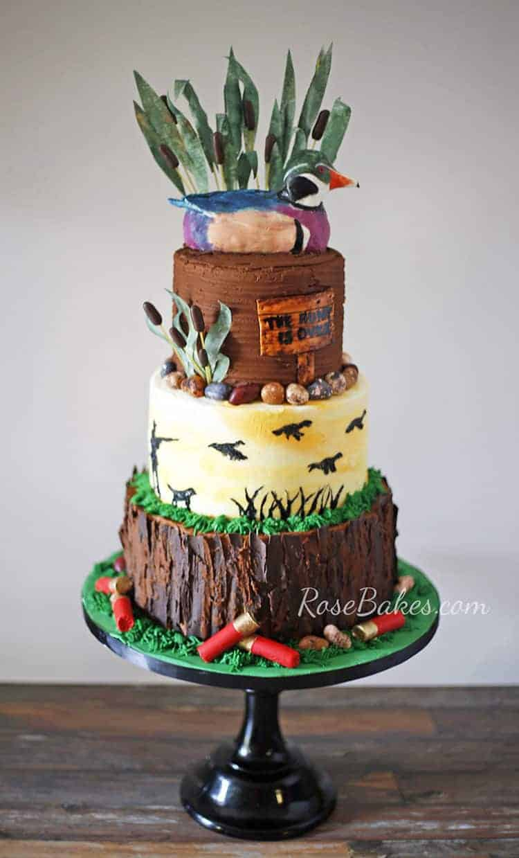 duck hunting groom's cake on black cake stand