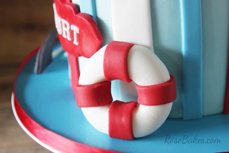 fondant life ring on cake board for shark attack cake