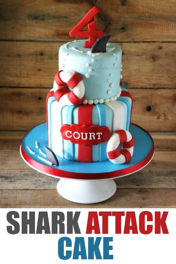 Shark Attack Cake on White Cake stand with wood back drop