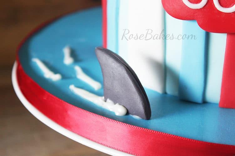 shark fin on cake board for shark attack cake