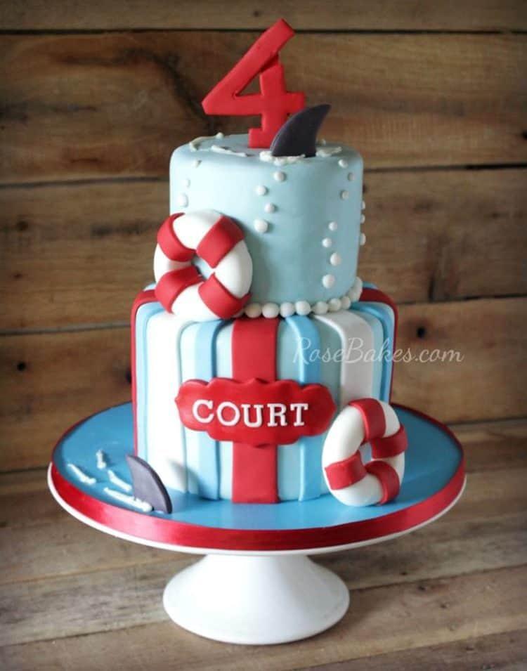 Shark attack cake on white cake stand