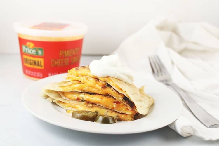Spicy Pimento Cheese Quesadillas with bowl of Price*s Pimento Cheese and fork on white plate