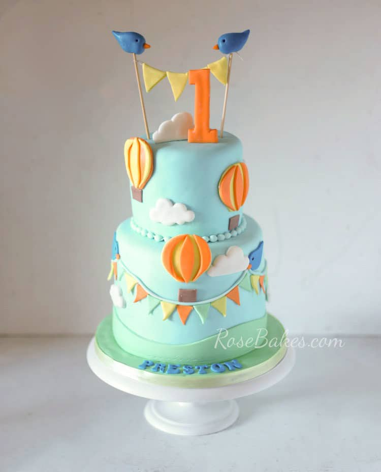Boy Blue Hot Air Balloon Birthday Cake With Orange And Yellow Decorations Birds