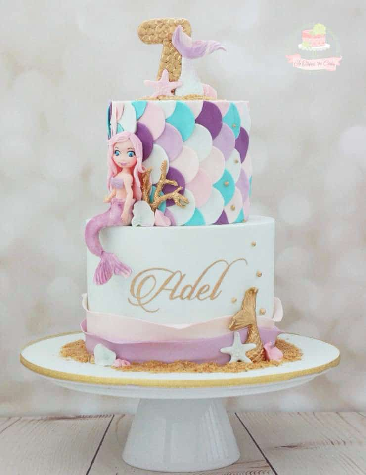 pastel mermaid cake with gold details and sculpted mermaid