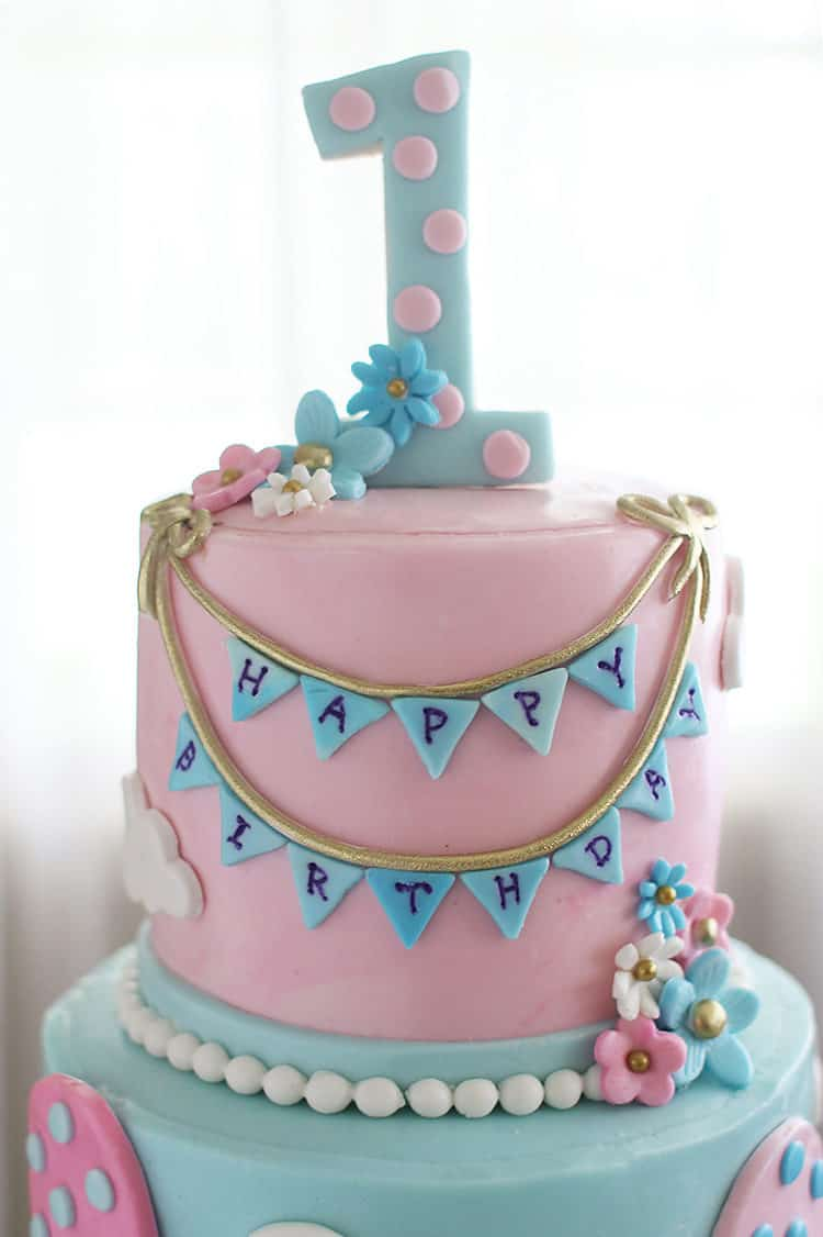Top tier hot air balloon cake with bunting and 1 for first birthday