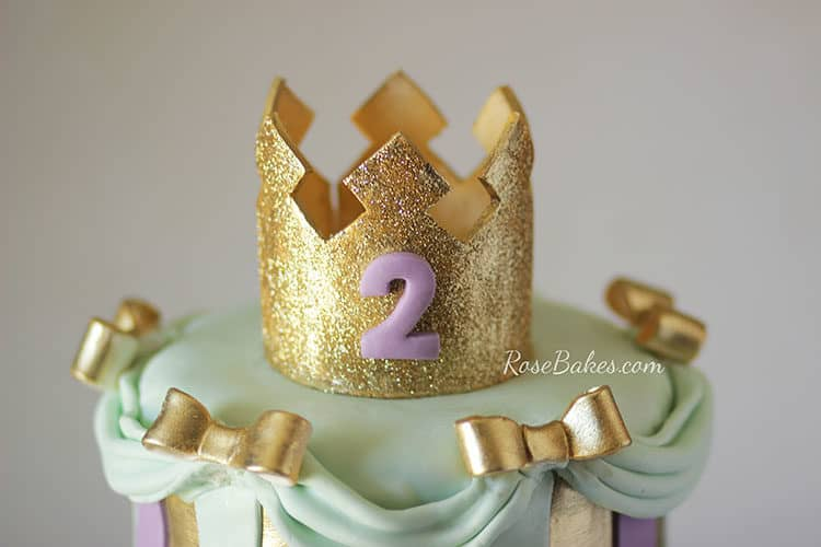 gold crown cake topper on princess cake