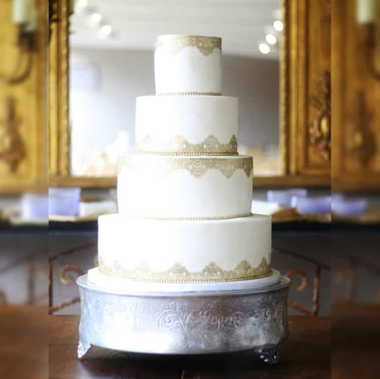 White Wedding Cake Fondant Panels with Gold Lace Borders and Pearls on Silver Platform Stand