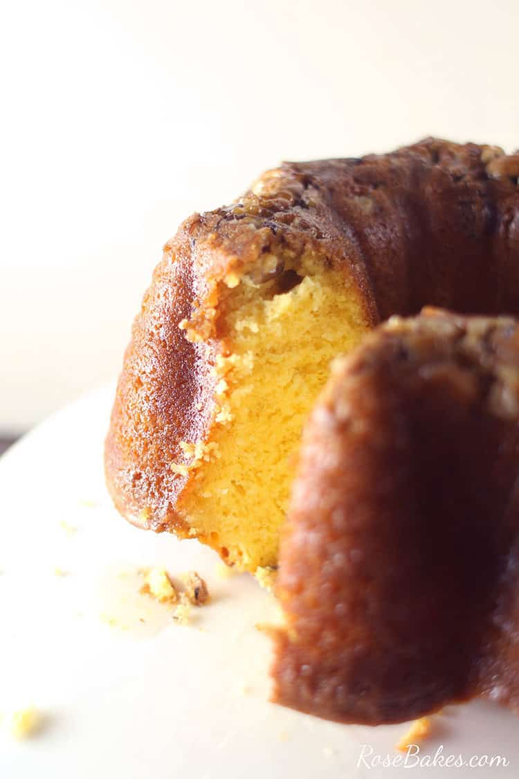 sliced golden rum cake with pecans and butter rum sauce