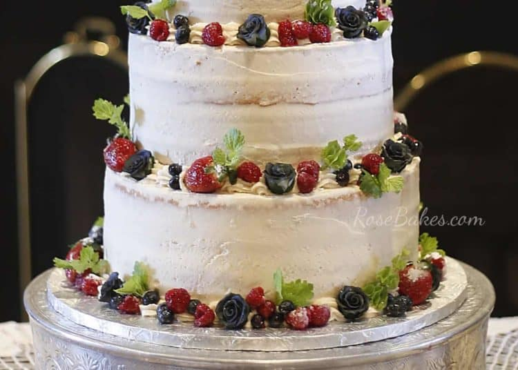 Close up Semi Naked Wedding Cake with Fresh Fruit and Greenery