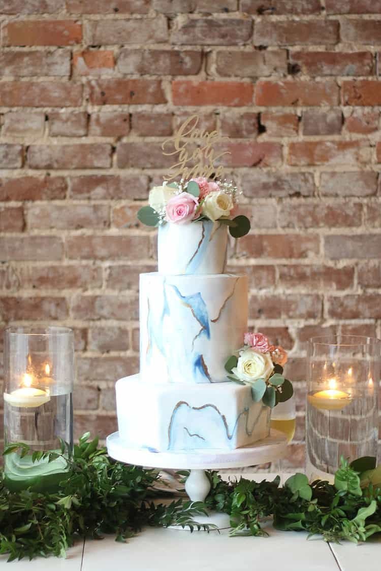 This Marbled Fondant Wedding Cake with Navy, Gold and Pink