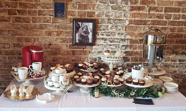 Groom's Table with a coffee theme. Cucpakes on cake stands with coffee maker