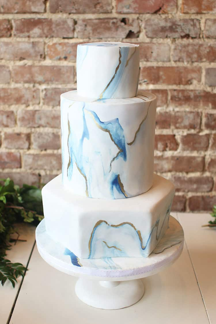 Marbled Fondant Wedding Cake with Navy, Gold and Pink before the flowers were added. on a white cake stand