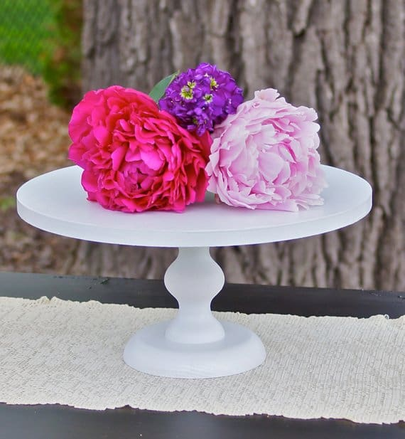 white pedestal cake stand with flowers