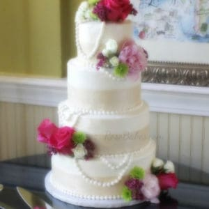 champagne pearls hot pink flowers wedding cake