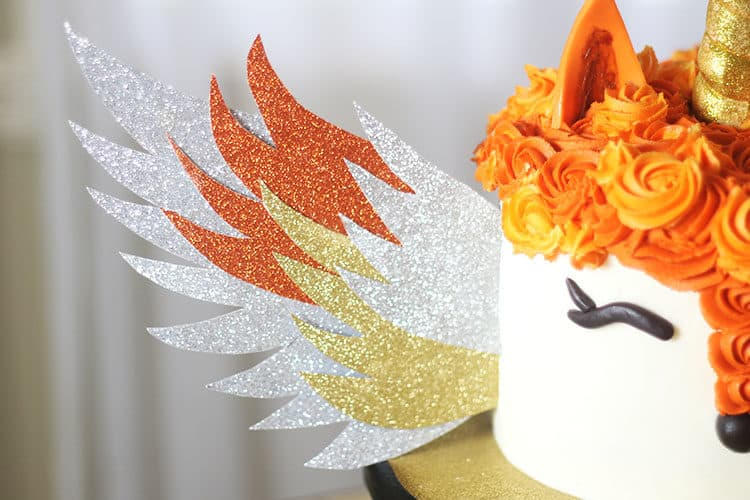 glitter paper wings on fox unicorn cake with wings