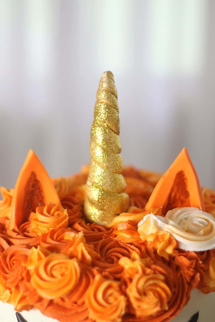 gold glitter horn on fox unicorn cake with wings