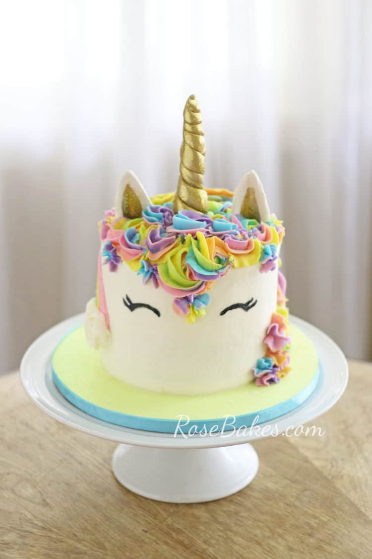 unicorn cake on white cake stand