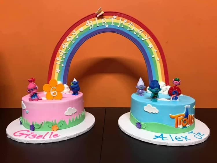 Trolls cakes for a boy and girl with giant rainbow connecting them!
