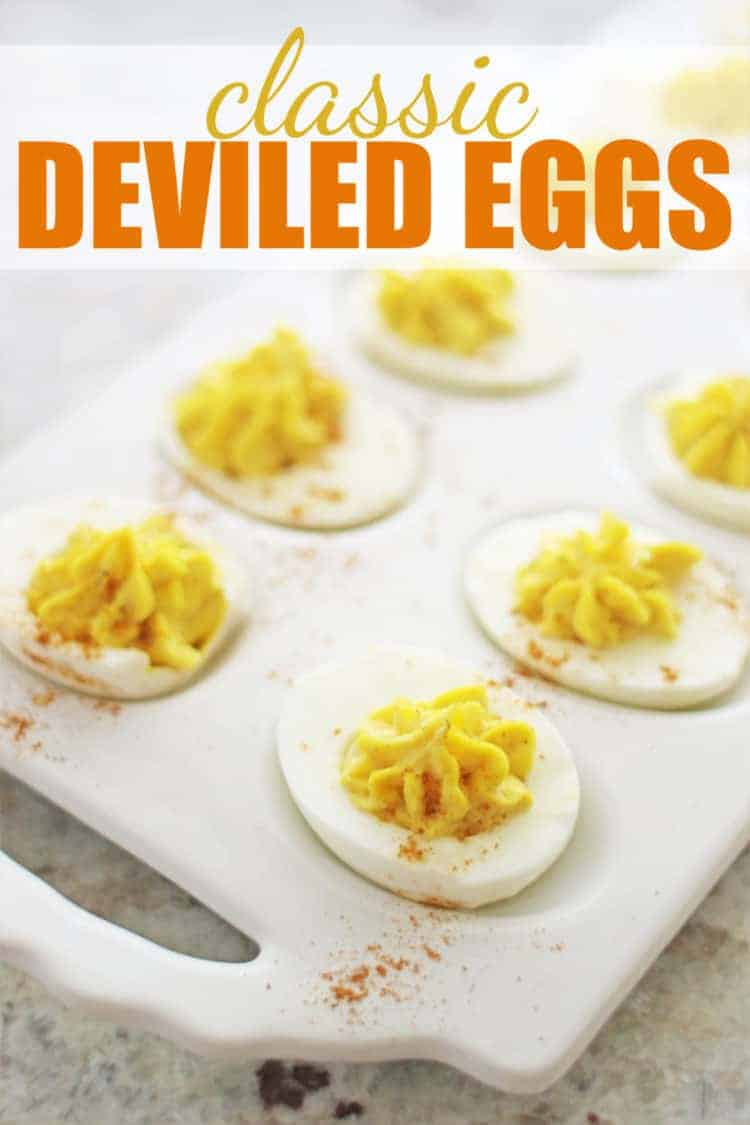 classic deviled eggs on white platter with pinterest text