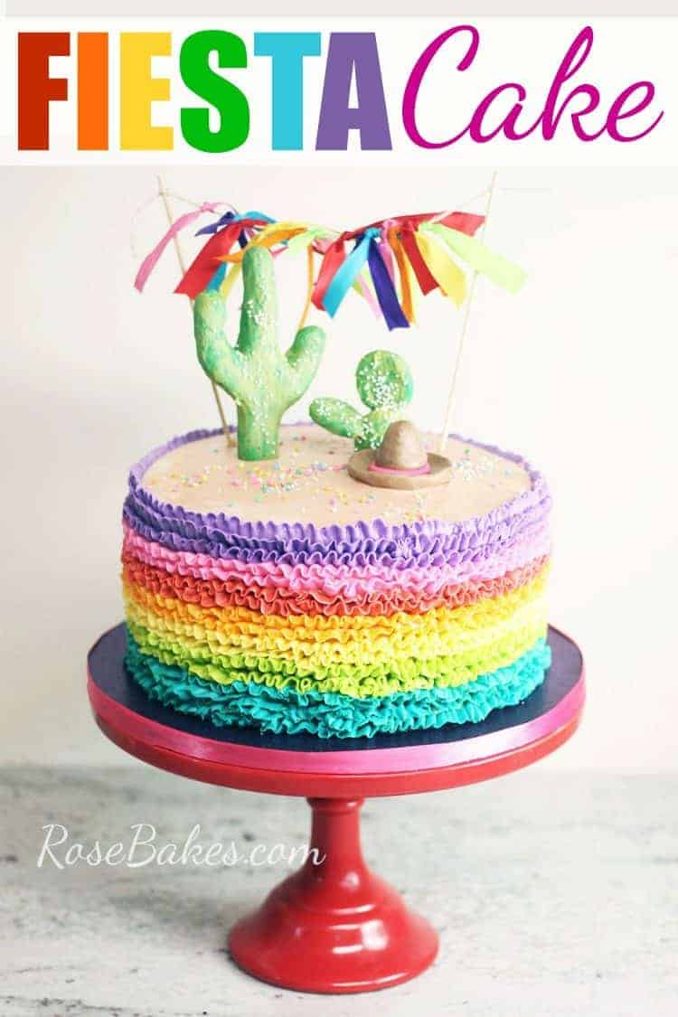 rainbow ruffles buttercream fiesta cake on red cake stand with pinterest text