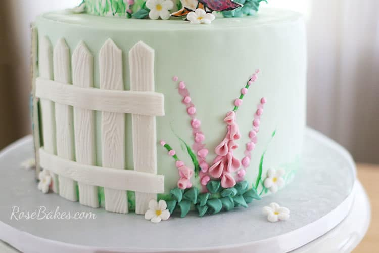 Beatrix Potter Cake with white fence and foxglove flowers