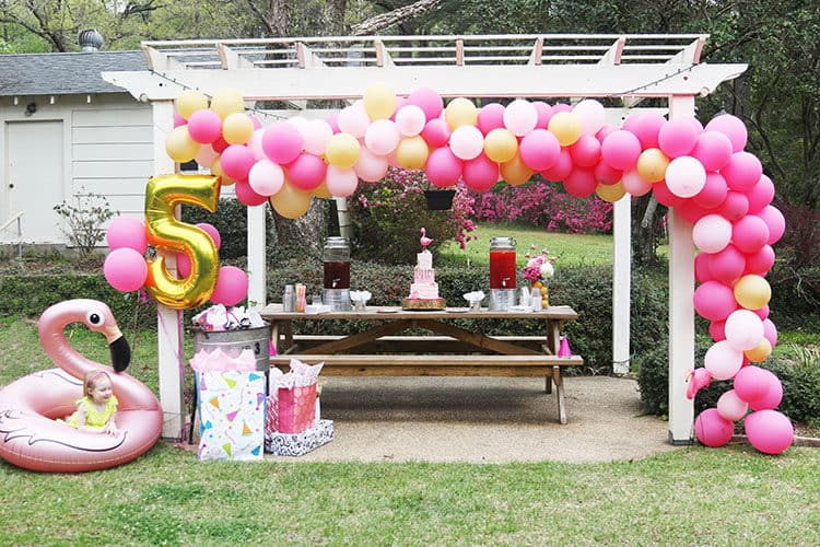 Balloon Display for Flamingo Party with Flamingo Cake Centerpiece