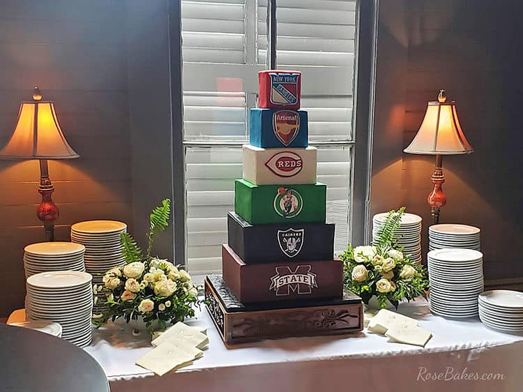 sports themed groom's cake on table with plates