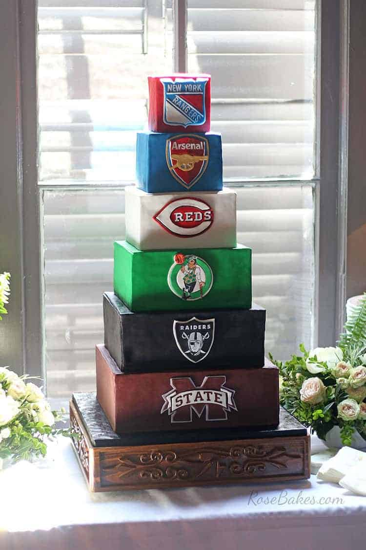 six tiered sports themed grooms cake