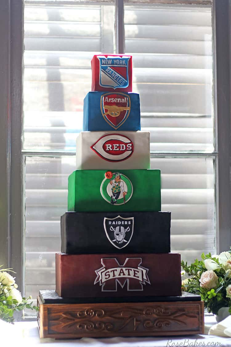 sports grooms cake on wooden cake stand