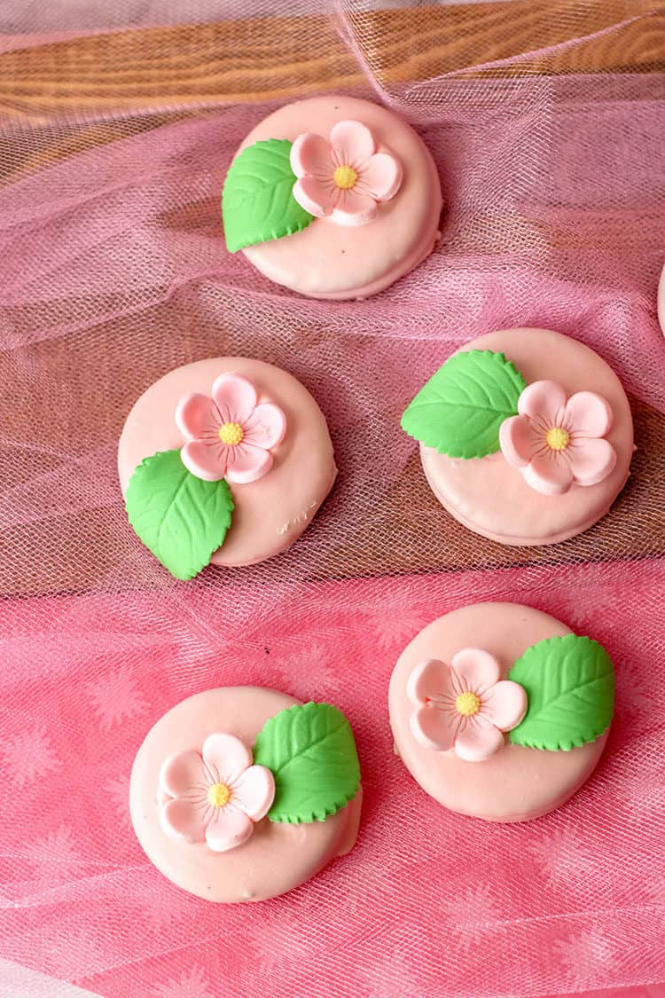 easy flower oreos - pink with pink flowers and leaves on pink lace