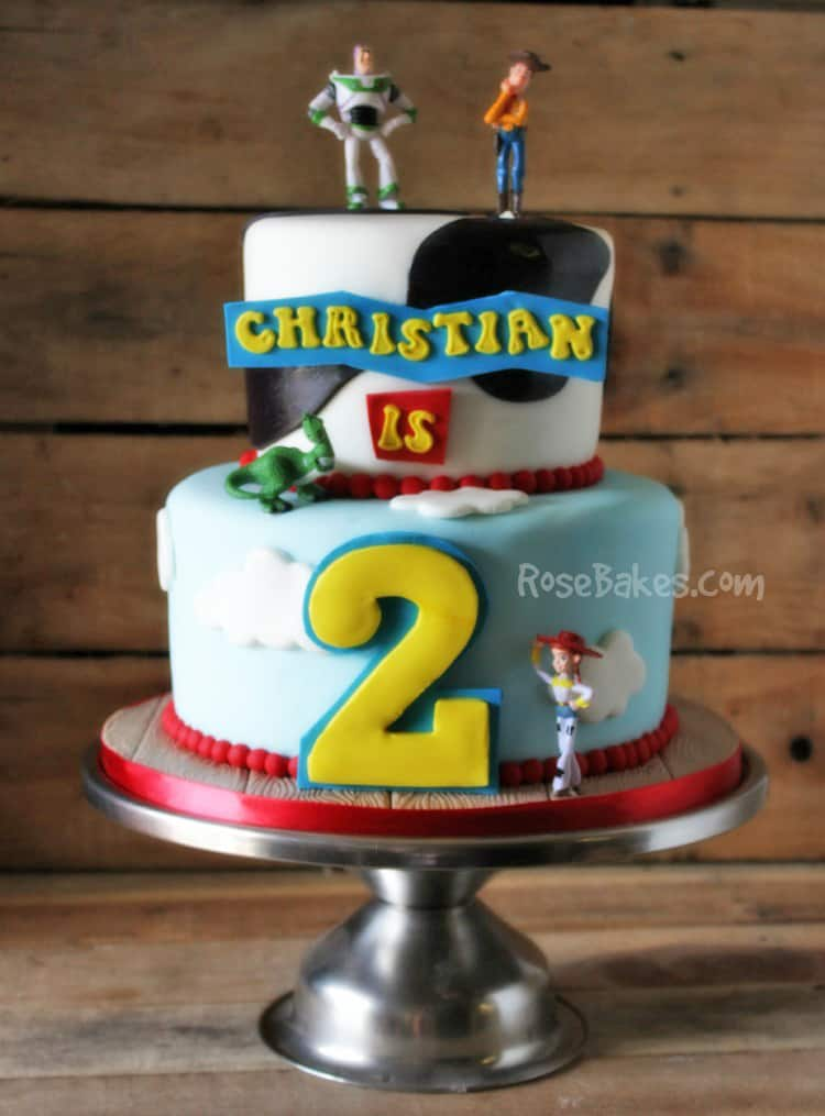 fondant toy story birthday cake on silver stand