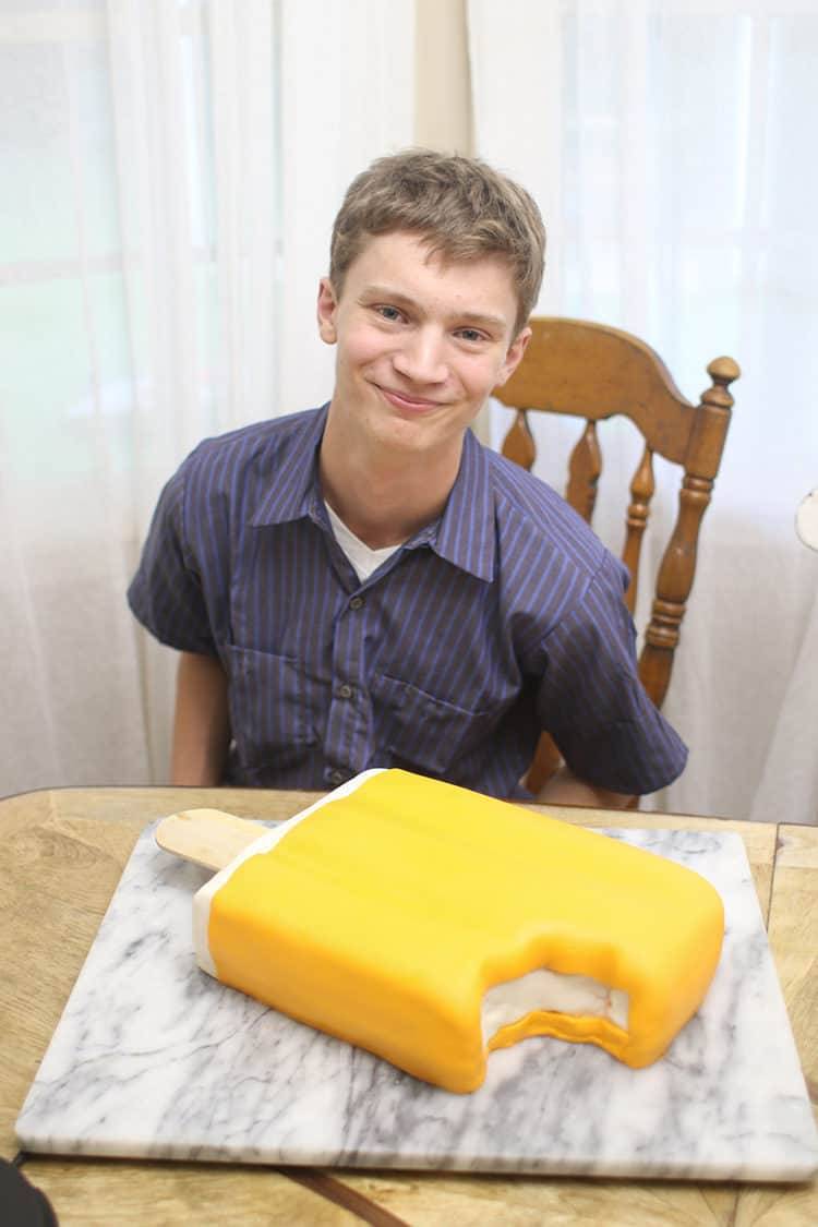 orange creamsicle cake or dreamsicle cake on a marble slab for my son joshua