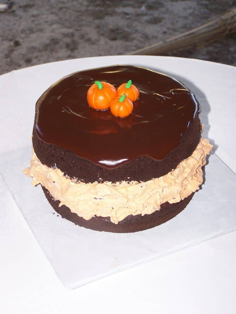Oreo Cookie cake with orange cream filling and pumpkin toppers