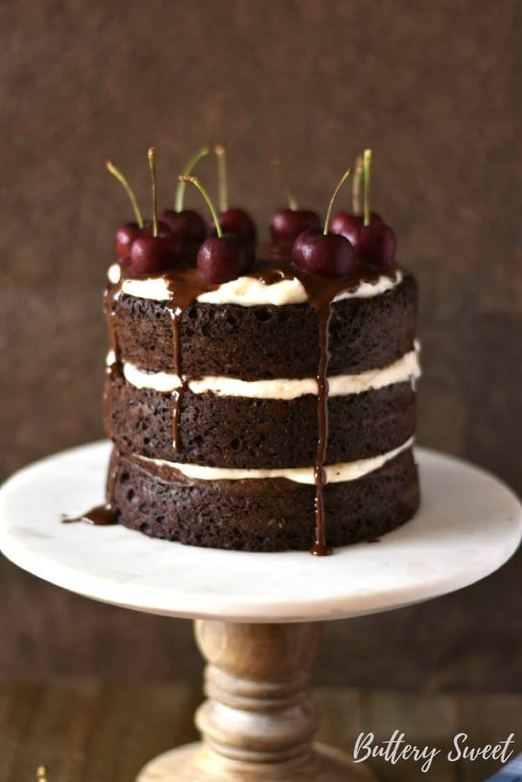 naked black forest cake with fresh cherries