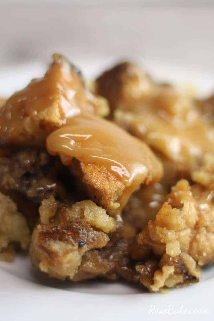 Jack Daniels Bread Pudding with caramel sauce on a white plate