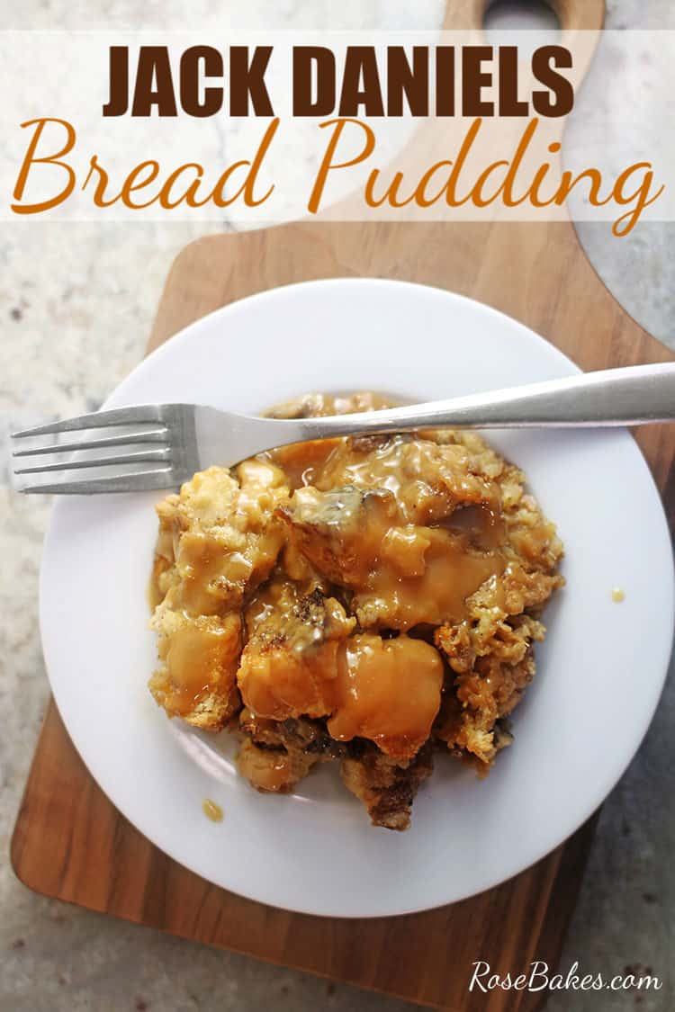 Jack Daniels Bread Pudding on a white plate with fork and cutting board underneath