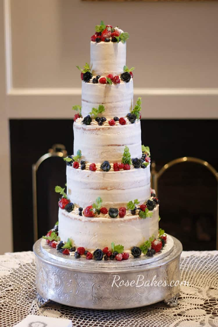 nearly naked wedding cake with fresh fruit