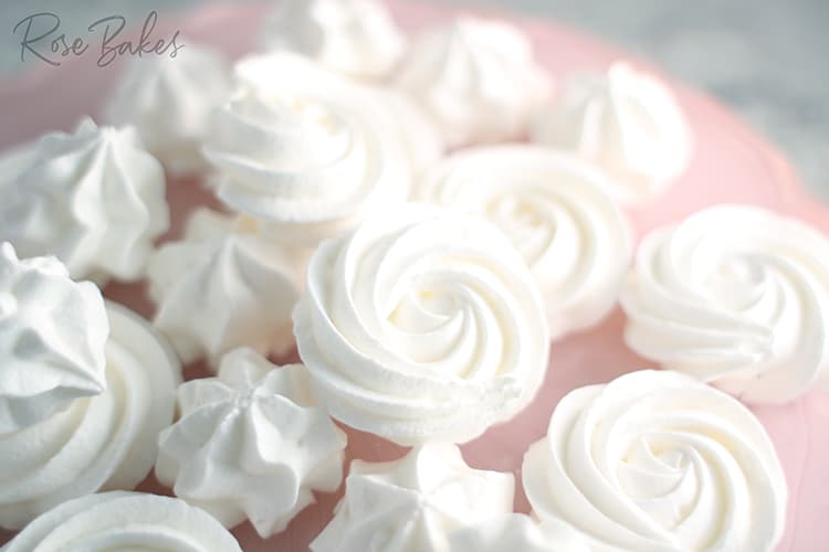 Meringues on a pink cake plate
