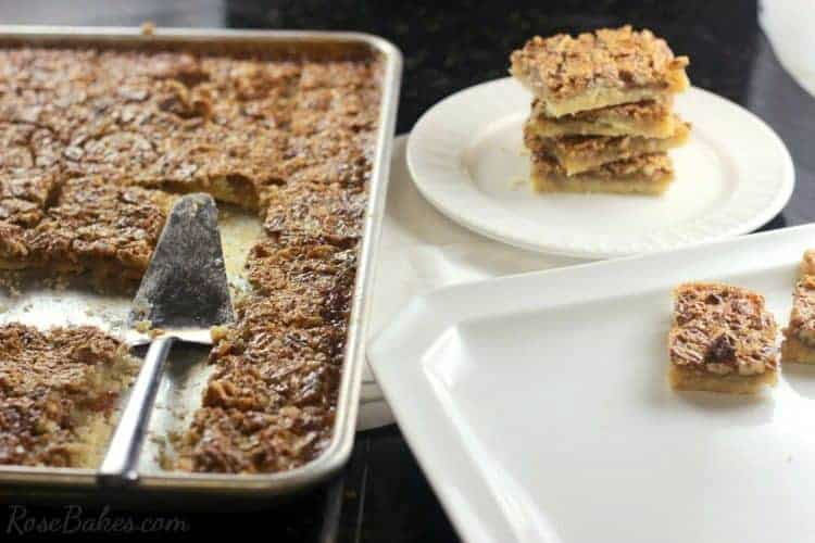 Easy Pecan Pie Bars recipe in a sheet pan, some cut out