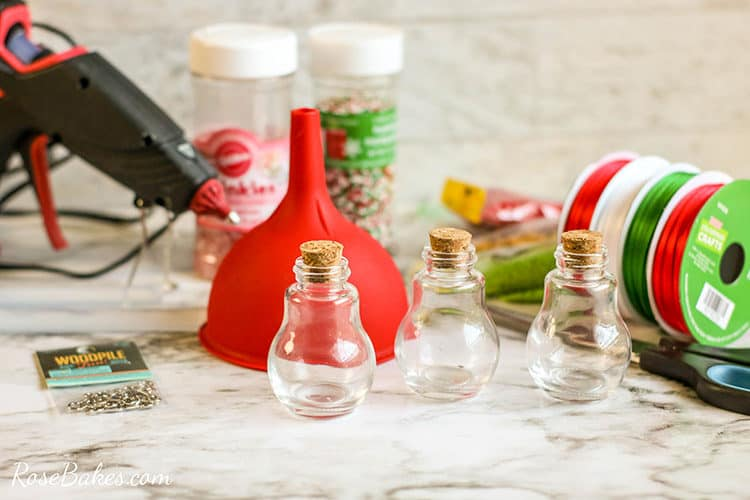 supplies for DIY Sprinkles ornaments on a table