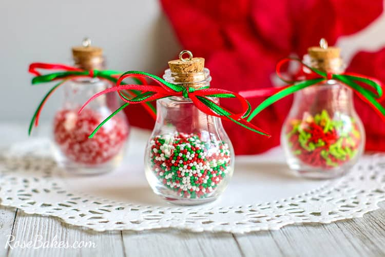 DIY Sprinkles Ornaments on a white doily with ribbons