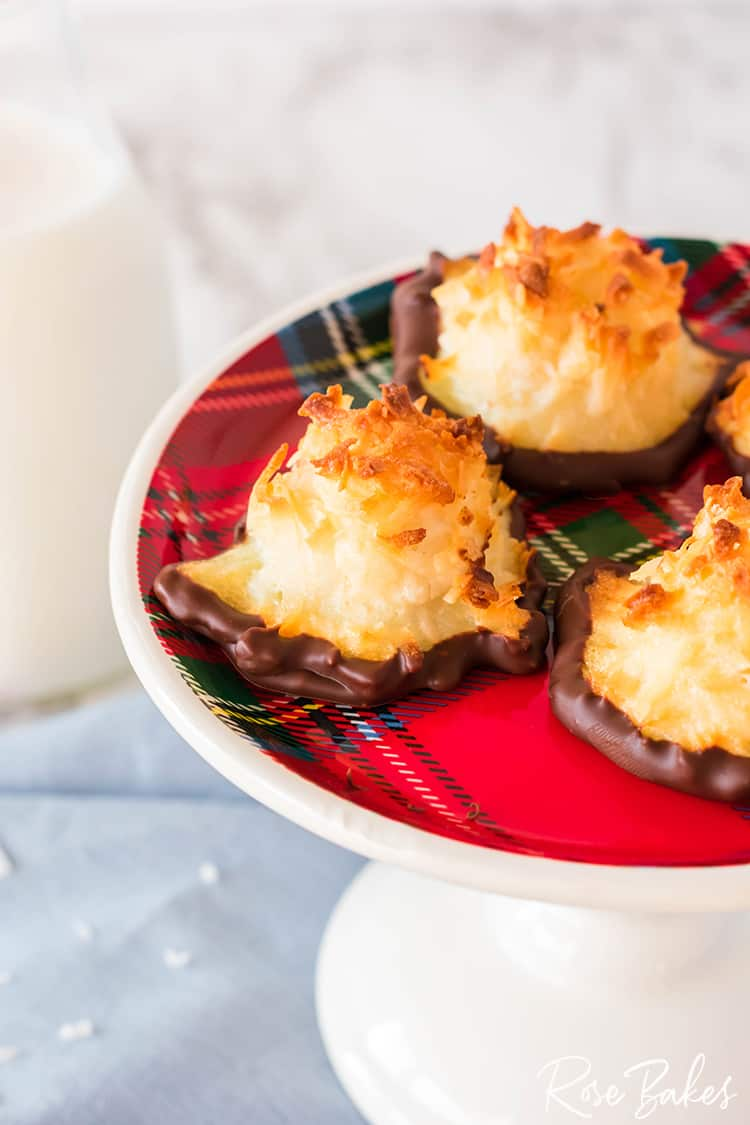 Plaid plate of coconut macaroon cookies dipped in chocolate.