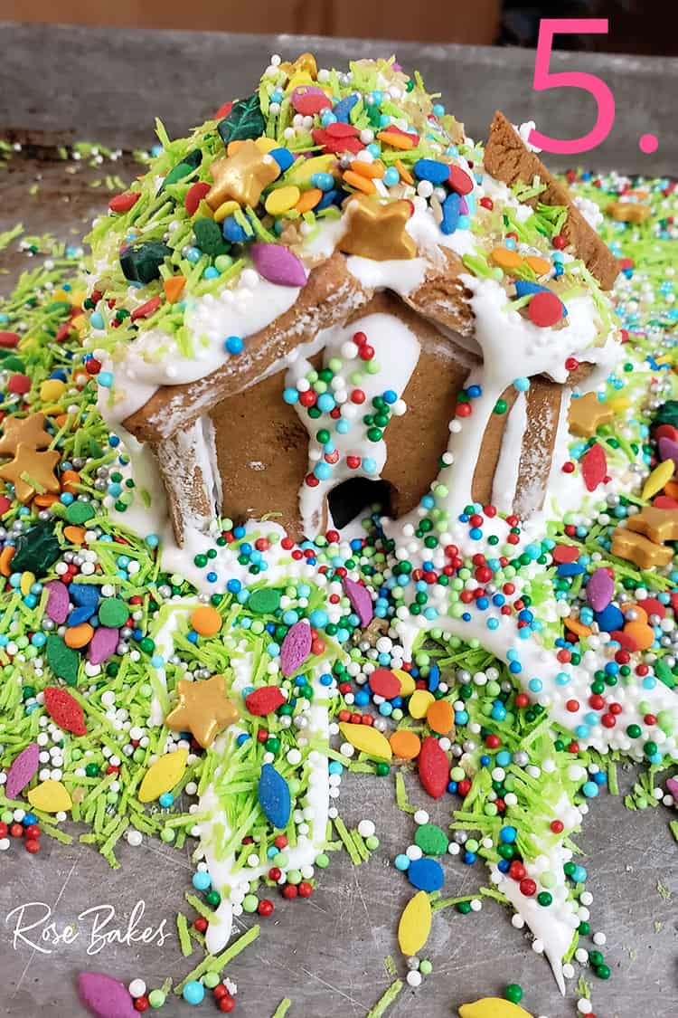 Mini gingerbread house with lots and lots of sprinkles and decorations done by a kid