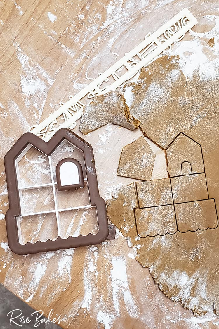 Mini Gingerbread House Cookie Cutter next to Gingerbread dough cut out with cutter