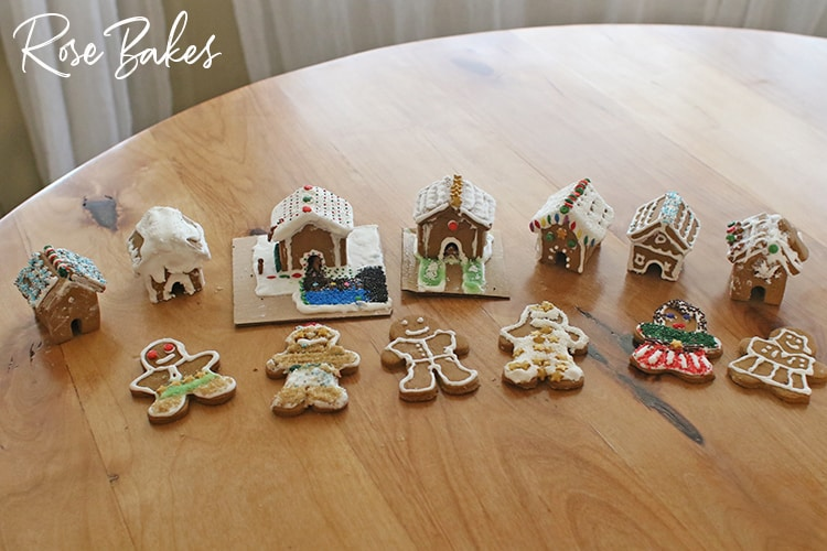 Seven mini gingerbread houses and 6 gingerbread men and women for How to Make Mini Gingerbread Houses with Kids post