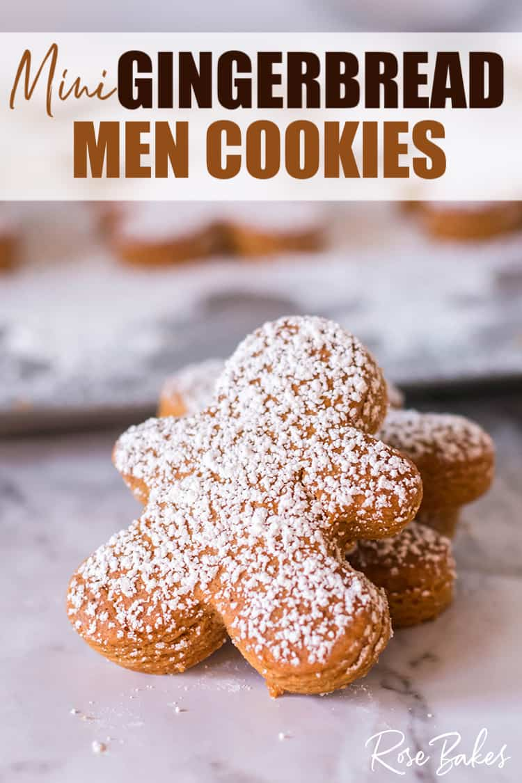 Mini Gingerbread Men Cookies with powdered sugar sprinkled on