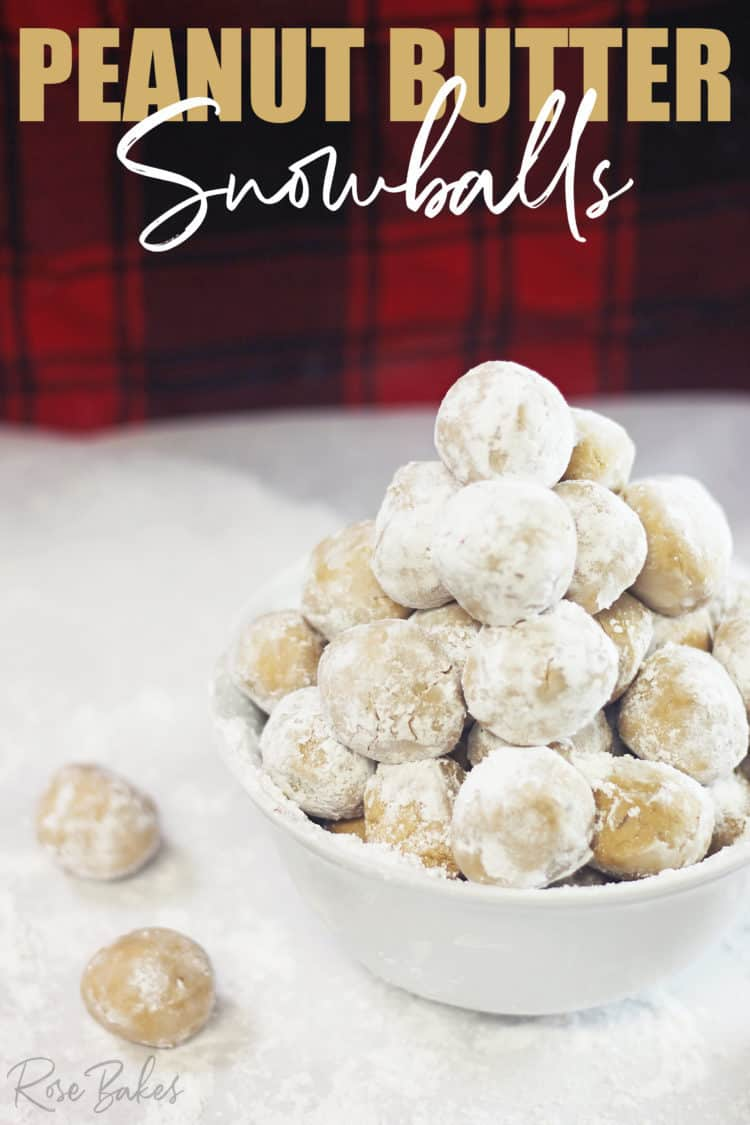 white bowl of Peanut Butter Snowballs with powdered sugar
