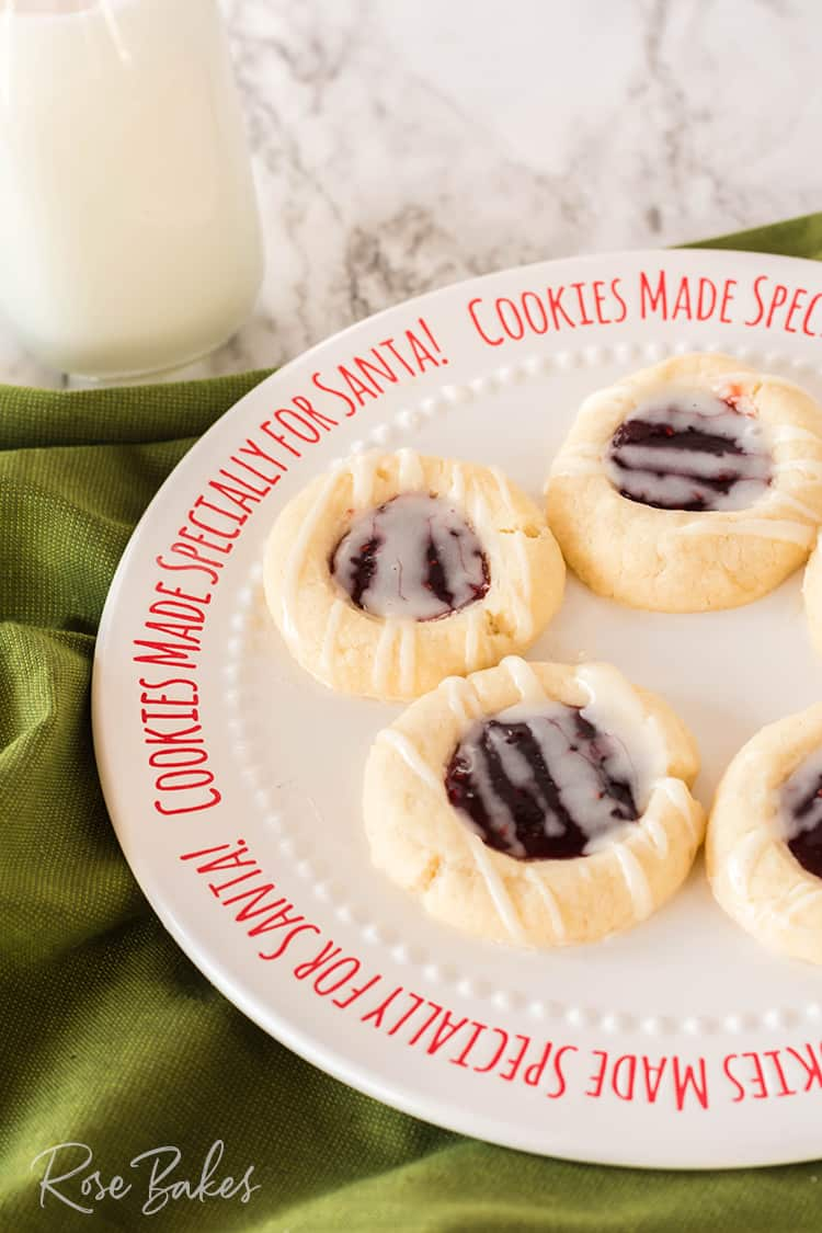 Raspberry Thumbprint cookies with a vanilla almond glaze on a cookie plate for Santa
