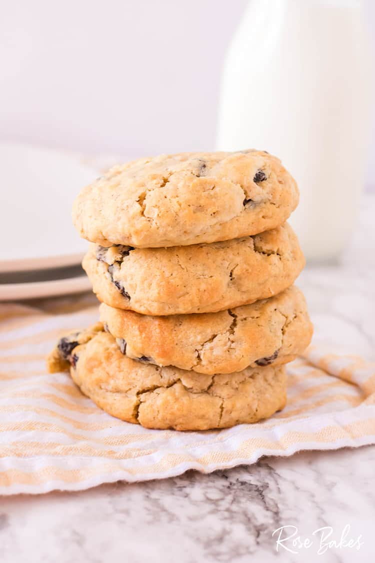 stacked Soft Oatmeal Raisin Cookies on yellow cloth